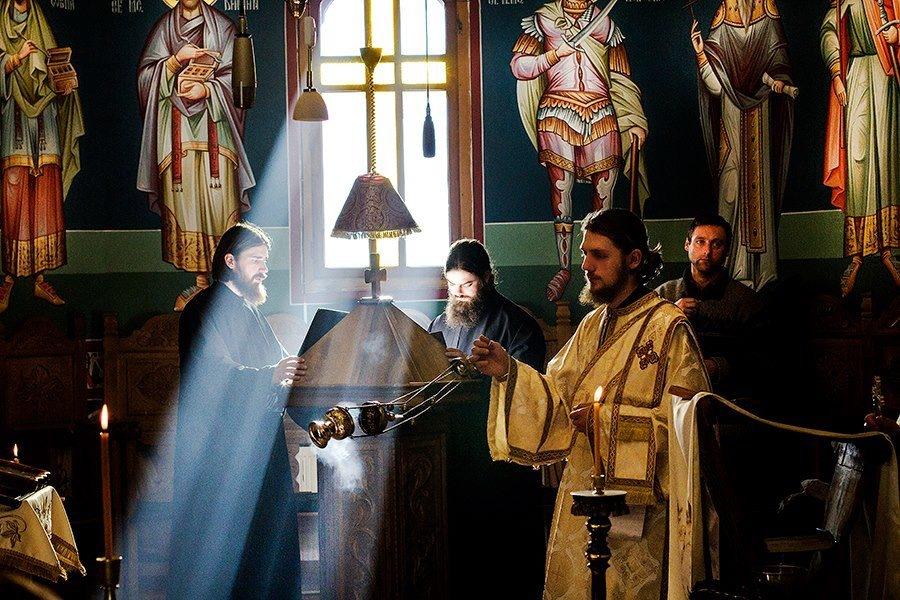 religious-service-at-orthodox-church-priests-romanian-men-bucovina-romania